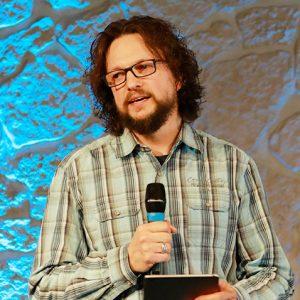 Pastor Alex Guse bei einer Predigt